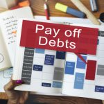 Paying Off Debt by Alan Newcomb